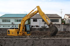 Excavator working. At the Construction site in Bangkok,Thailand Royalty Free Stock Image