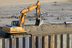 Excavator working at construction site Royalty Free Stock Image