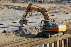 Excavator working at construction site Royalty Free Stock Photo