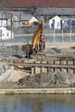 Excavator working at construction site Stock Photos