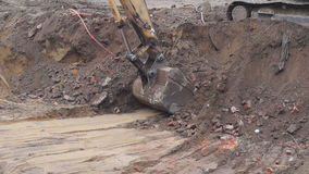 Excavator working on a construction site stock footage