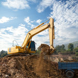 Excavator working in construction site Royalty Free Stock Image