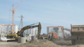 Excavator working on construction site stock video