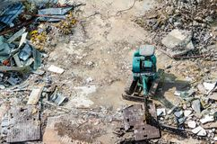 An excavator working at demolition site. An excavator working at demolition building site in Bnagkok, Thailand Royalty Free Stock Images