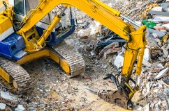 An excavator working at demolition site. An excavator working at demolition building site in Bnagkok, Thailand Stock Images