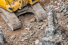 An excavator working at demolition site. An excavator working at demolition building site in Bnagkok, Thailand Stock Photos
