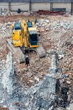 An excavator working at demolition site. An excavator working at demolition building site in Bnagkok, Thailand Stock Photography