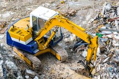 An excavator working at demolition site. An excavator working at demolition building site in Bnagkok, Thailand Stock Image