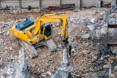 An excavator working at demolition site. An excavator working at demolition building site in Bnagkok, Thailand Royalty Free Stock Photo
