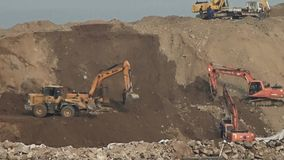 Excavator working & dumper truck on construction site. Excavator working & dumper truck on construction site.  gh2_06112 stock footage
