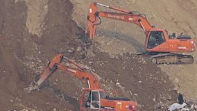Excavator working & dumper truck on construction site. Excavator working & dumper truck on construction site.  gh2_06115 stock footage