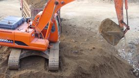Excavator working & dumper truck on construction site. Excavator working & dumper truck on construction site.  gh2_06124 stock footage