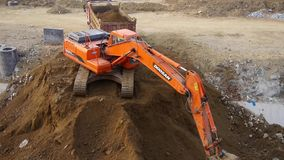 Excavator working & dumper truck on construction site. Excavator working & dumper truck on construction site.  gh2_06121 stock footage