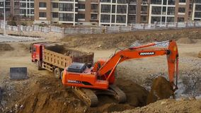 Excavator working & dumper truck on construction site. Excavator working & dumper truck on construction site. gh2_06120.mov stock footage