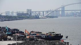 Excavator working & dumper truck on construction site,shanghai pier & shipping. Excavator working & dumper truck on construction site,shanghai pier & stock video