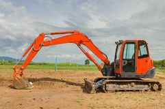 Excavator working in the farmland Stock Images