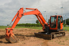 Excavator working in the farmland Royalty Free Stock Image