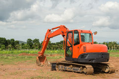 Excavator working in the farmland Royalty Free Stock Photo