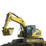 Excavator working on the groud. An excavator working on the ground Stock Photos