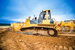 Excavator working and moving earth in construction site Stock Photography