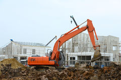 Excavator. Working in new housing building project Royalty Free Stock Images