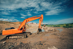 Free Excavator Working On Highway Construction Site. Details Of Excavator Digging In Water And Dirt For Viaduct Construction Stock Images - 96447654