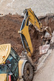 Excavator working with red soil and dusty Stock Photography