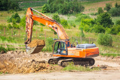 An excavator working removing ground Royalty Free Stock Images