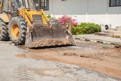 Excavator working on the Repair of pipe water on road Stock Images