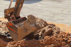 Excavator working on the Repair of  pipe water and sewerage on road Royalty Free Stock Photography
