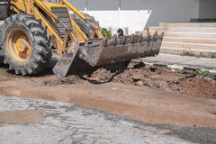 Excavator working on the Repair of pipe water and sewerage Stock Photo
