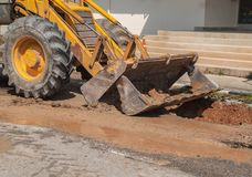 Excavator working the Repair of pipe water sewerage on road Royalty Free Stock Photography