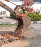 Excavator working on the Repair of pipe water and sewerage on road Stock Photos