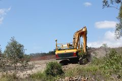 Excavator working in a residential Estate Royalty Free Stock Photo
