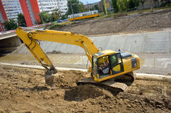 Excavator working on the river bed Stock Photos