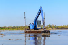 Excavator working in the river Royalty Free Stock Photo