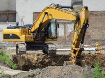 Excavator. Is working at the road construction Royalty Free Stock Image