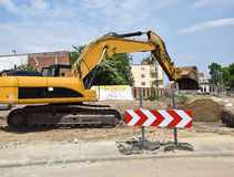 Excavator is working. At the road construction Stock Photo