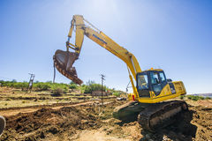 Excavator working on road. Royalty Free Stock Photos