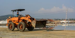 An excavator working on the salt field stock photography