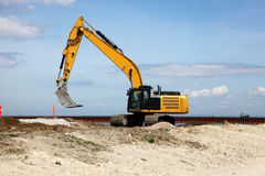 Excavator works on a construction site Stock Image