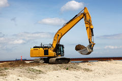 Excavator works on a construction site Stock Photos