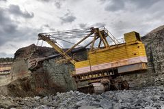 Excavator works or ore at opencast mining Royalty Free Stock Photo
