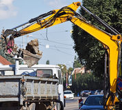 Excavator works at the road construction Stock Photography
