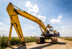 Excavator. Yellow Excavator at Construction Site. Wide angle view Stock Image