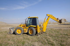 Excavator. Yellow digger loader side view Stock Photography