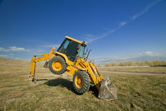 Excavator. Yellow digger loader side view Royalty Free Stock Photo