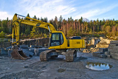 Excavator by ystehede quarry Royalty Free Stock Image