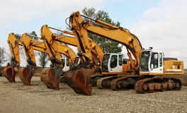 Excavators. Parked tracked excavators at workplace Stock Photography