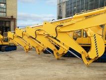 Excavators. New excavators built at the factory yard Royalty Free Stock Photo